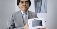 Satoru Iwata holding his baby, the Wii U Controller