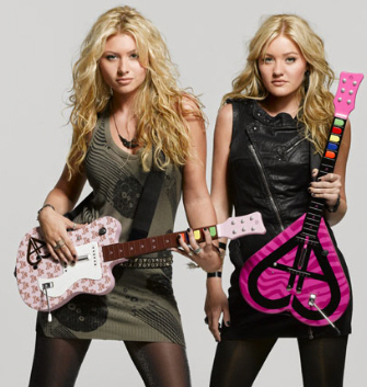 Aly & AJ showing off their Rock Band/Guitar Hero guitars