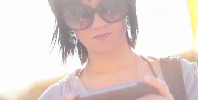 Woman Playing PlayStation Vita